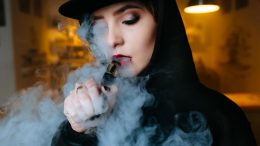 Young Woman Vaping E Cig