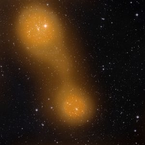 a bridge of hot gas that connects galaxy clusters Abell 399 (lower center) and Abell 401