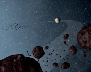 asteroids that lap the sun in the same orbit as Jupiter are uniformly dark with a hint of burgundy color