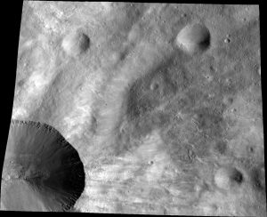 close up of part of the rim around the crater Canuleia on the giant asteroid Vesta