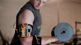electronic trainer gives bulging biceps