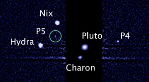 five moons orbiting the distant, icy dwarf planet Pluto