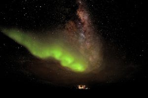 green glow of Aurora Australis high over Concordia station