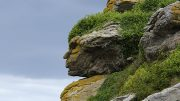 Rock formation resembling a human face in Ebihens, France