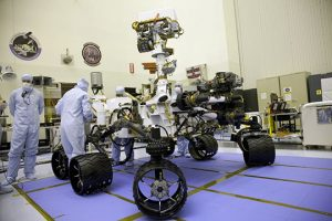 NASA Workers with Curiosity Rover