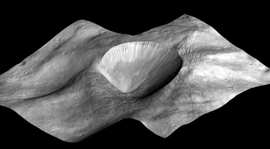perspective view of a layered young crater in the Rheasilvia basin at Vesta