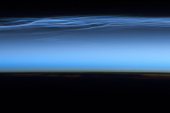 picture of noctilucent clouds near the top of Earth's atmosphere
