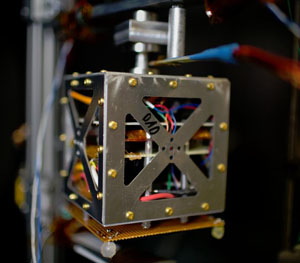 small satellite inside a vacuum chamber simulates space-like conditions