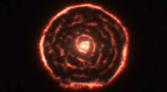 unexpected spiral structure in the material around the old star R Sculptoris
