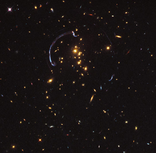 zoom lens in space gives close-up look at the brightest distant magnified galaxy