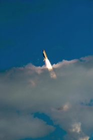 Space Shuttle Atlantis Breaks Through the Clouds